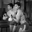 Crossfit fitness lifting Kettlebell woman at mirror workout