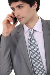 Successful businessman making a call