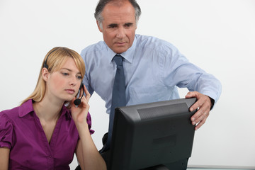 Businessman and woman at a computer