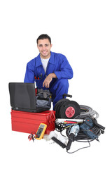Electrician with equipment, studio shot