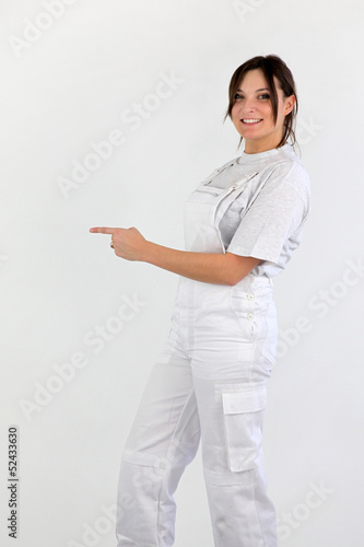 Female decorator pointing