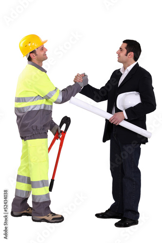 businessman and craftsman shaking hands