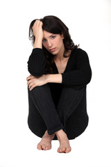 Woman sitting pensively