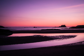 Ship across the ocean at Sunset, in Tofino beach Canada