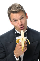 Male host singing with banana