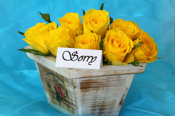 Sorry note with yellow roses  in vintage wooden flower box