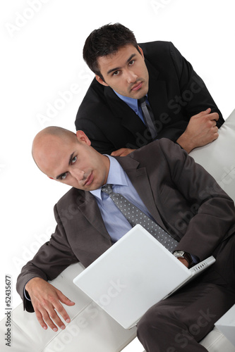 Two businessmen on a sofa
