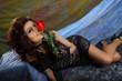 Glamour girl holding red rose