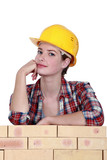 Thoughtful female construction worker