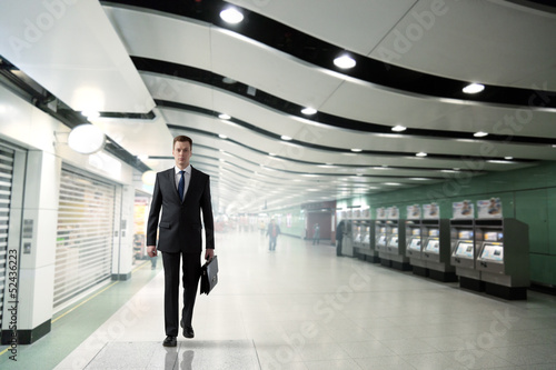 business man walking in subway