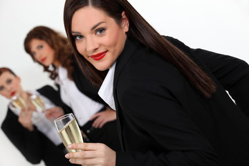Three businesswomen drinking champagne
