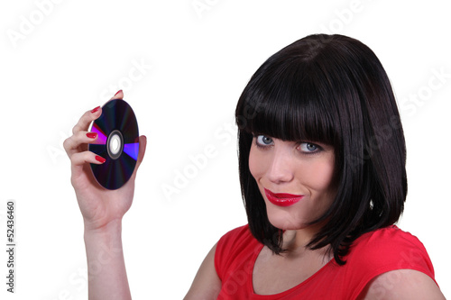 brunette woman showing a compact disc