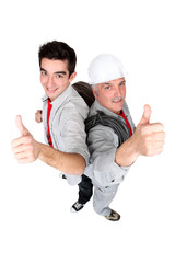 Thumbs up from two electricians