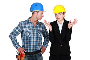 female architect being assertive with craftsman