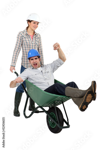 Workers with a wheelbarrow