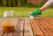 Painting wooden patio deck with protective varnish - 52436881