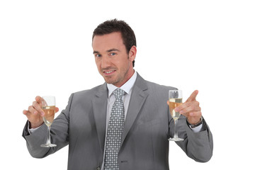 Man holding champagne glasses