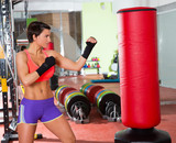 Fototapety Crossfit woman boxing with red punching bag