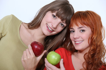 Women holding apples