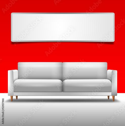 Sofa vor roter Wand mit Bild