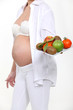 Pregnant woman with bowl of fruit