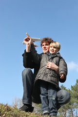 Father and son with a toy plane