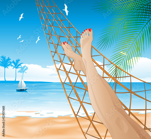 Woman lying in the hammock on the beach