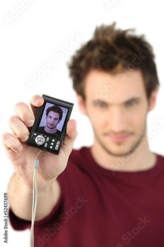 Man showing his portrait on camera