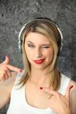 Woman winking with audio headphones