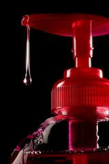 Liquid soap drop red bottle