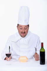 Chef eating fast-food and drinking wine