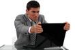 Businessman alarmed at his laptop