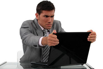 Businessman alarmed at his laptop