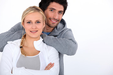 Couple smiling with arms crossed