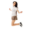Jumping school girl in plaid skirt and sneakers