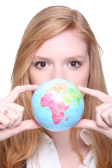 young woman showing a little globe