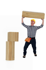 Man having difficulty lifting wooden block
