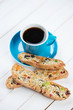 Fresh espresso and italian biscotti on wooden boards