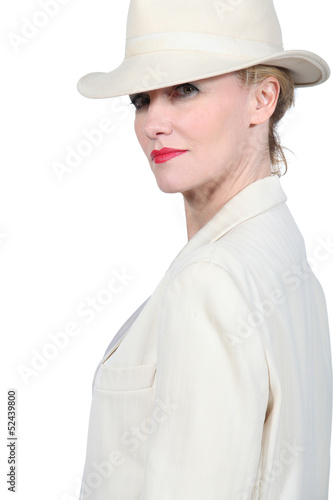 Woman wearing cream coloured suite