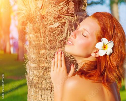 Pretty woman on tropical resort