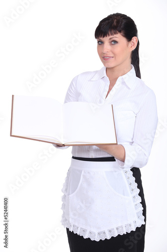 Waitress holding menu