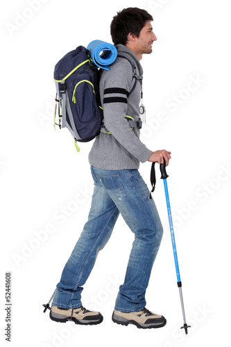 a man ready for backpacking in mountains