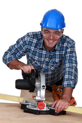 craftsman working with an electric saw