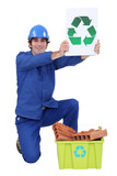 Manual worker encouraging people to recycle