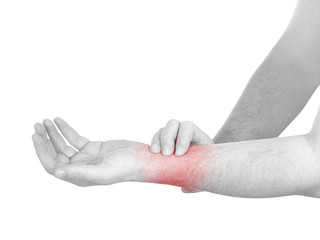 Acute pain in a man wrist. Male holding hand to spot of wrist pa