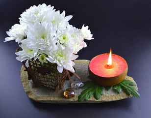 White flowers with red candle