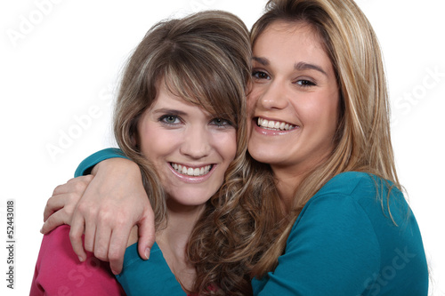 two girlfriends embracing