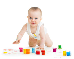 crawling baby with a finger's paints