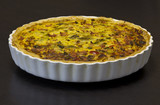 Quiche Lorraine in a white, used baking tin