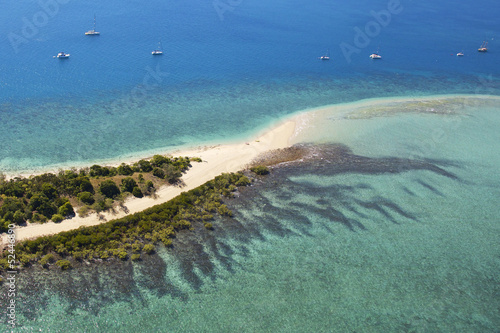 Aerial tropical sand island and reef